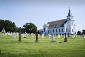A church and the graveyard — Stock Photo