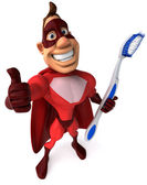 Superhero and toothbrush — Stock Photo