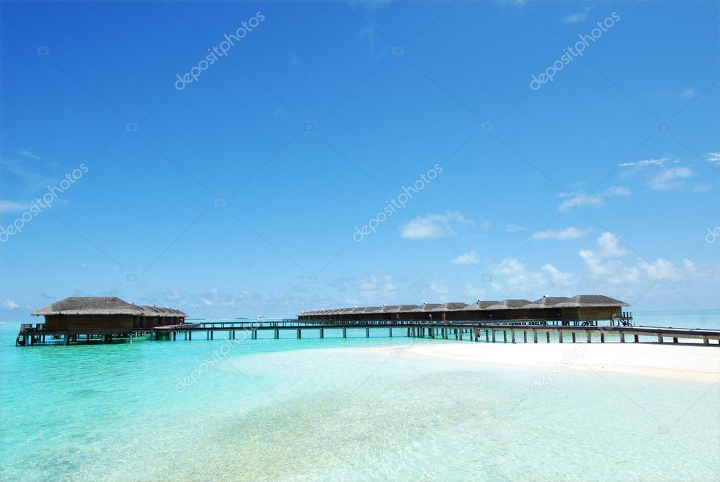 Tropical beach with water villas  — Lizenzfreies Foto #4549634