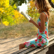 Young girl reading a book — Stock Photo #5143328