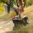 Stock Photo: Young girl reading a book