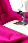 Sewing machine and a pink fabric — Stock Photo