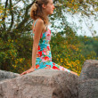 Young girl relaxing on the stone — Stock Photo