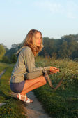 The girl, a sun-soft morning sunlight — Stock Photo