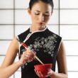 Chinese girl wuth food — Stock Photo
