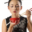 Girl eating oriental food — Stock Photo