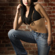 Asian girl in jeans and bra — Stock Photo