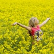 Happy girl in yellow field — Stock Photo #4701493