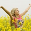 Happy girl in yellow field — Foto de Stock