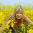 Happy girl in yellow field — Stock Photo #4701499