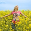 Happy girl in yellow field - Stock Photo