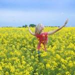 Happy girl in yellow field — Stock Photo #4701507