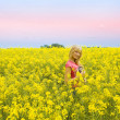 Blond girl in yellow field — Stock Photo #4701510