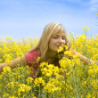 Smelling yellow flowers — Stock Photo #4701514