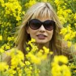 Girl in yellow field — Stock Photo