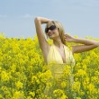 Girl in yellow field — Stock Photo #4701523