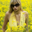 Girl in yellow field — Stockfoto #4701525