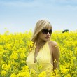 Girl in yellow field — Stock Photo #4701528