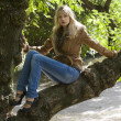 Blond on branch — Stock Photo #4701607