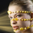 Yellow necklace around face — Stock Photo