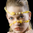 Yellow necklace mask - Stock Photo