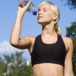Sporting girl drinking - Stock Photo