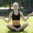 Girl in yoga pose — Stock Photo