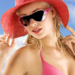 Red hat blue sky — Stock Photo