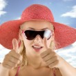 Portrait with pink hat and sunglasses — Stock Photo