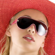 Portrait with red hat and sunglasses — Stock Photo
