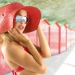 Portrait with red hat and sunglasses — Stock Photo #4702302