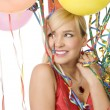 Red dressed girl in party with balloons — Stock Photo #4702314