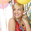 Red dressed girl in party with balloons — Stock Photo