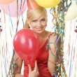 Red dressed girl in party with balloons — Stock Photo #4702320