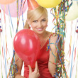 Red dressed girl in party with balloons - Stock Photo
