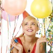 Red dressed girl in party with balloons — Stock Photo #4702323
