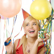 Pretty girl in party with balloons - Stock Photo