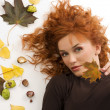 Red hair and fall leaf — Stock Photo