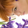 Girl with purple flower — Stock Photo