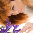 Girl with purple flower — Stock Photo #4702524