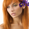 Red hair purple flower — Stock Photo #4702532