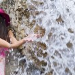 Pink hat and waterfall — Stock Photo
