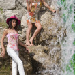 Girls posing near waterfall — Stock Photo #4702820