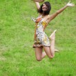 Foto Stock: Jumping on grass