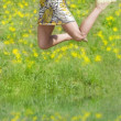 Jumping with hat — Stockfoto