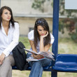 Women at bus stop — Stock Photo