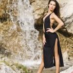 Brunette in waterfall — Stock Photo