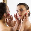 Cute brunette at mirror — Stock Photo