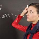Girl at blackboard — Stock Photo
