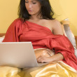 Red woman and computer — Stock Photo